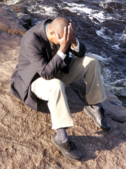 Dreamstime_depressed man rocks small